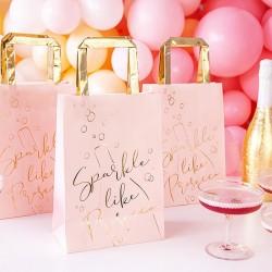 Torebki prezentowe dla dziewczyn na wieczór panieński. Torebki w różowym kolorze ze złotym zdobieniem.